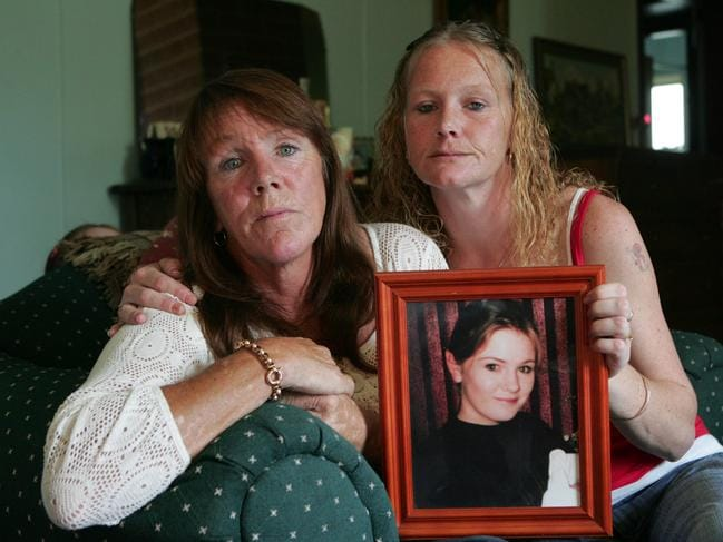 At Bathurst, abducted girl Jessica Small's mother Ricki Small and her sister Rebecca Small holding a photo of Jessica.
