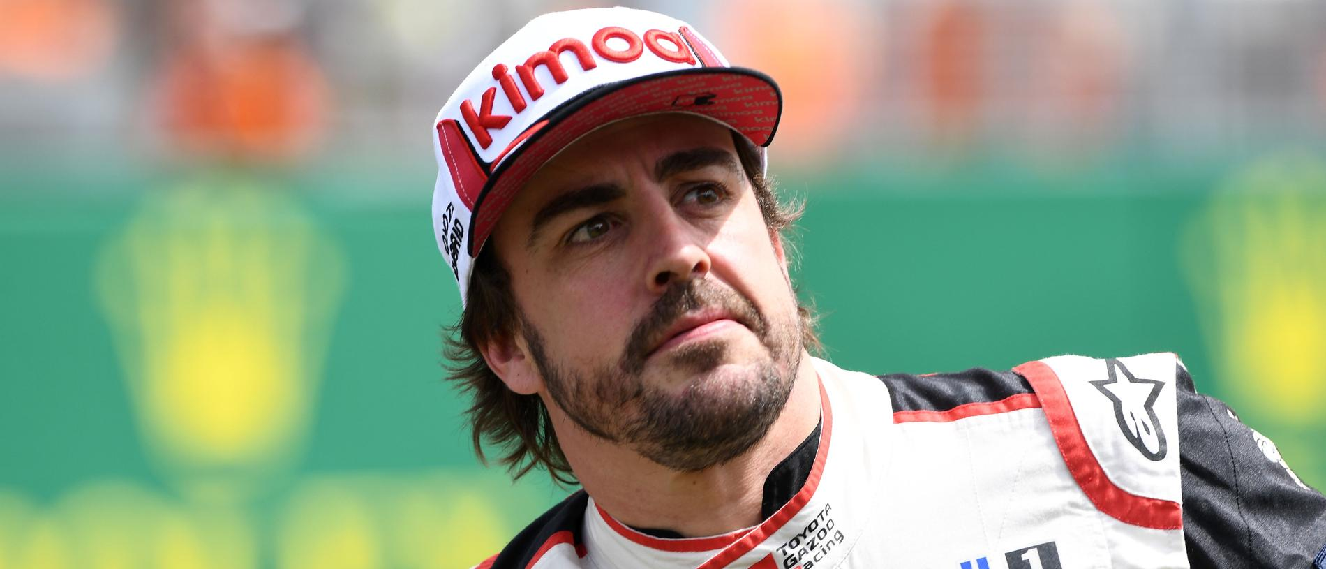 Spain's driver Fernando Alonso looks on after winning on his Toyota TS050 Hybrid LMP1 the 87th edition of the 24 Hours Le Mans endurance race on June 16, 2019, at Le Mans northwestern France. (Photo by Fred TANNEAU / AFP) (Photo credit should read FRED TANNEAU/AFP/Getty Images)
