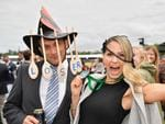 Kamahl Barhoush, of Ascot Vale, was among the first losers of the day, wearing a wooden spoon hat to prove it. But friend Hollie Summers, of Newcastle, came out a winner. 2017 Melbourne Cup at Flemington. Picture: Jason Edwards