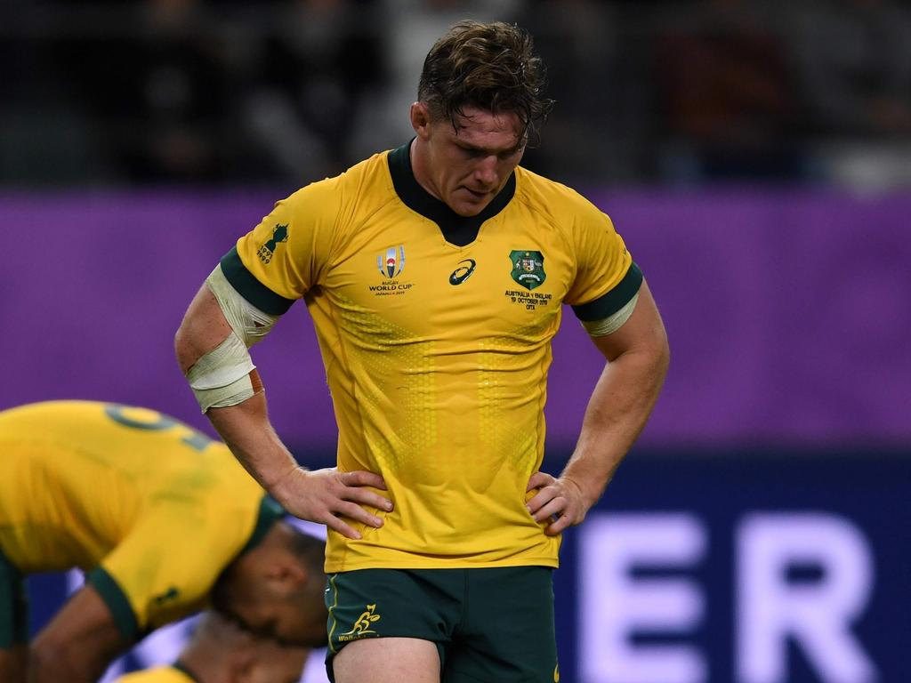 (FILES) This file photo taken on October 19, 2019 shows Australia's flanker Michael Hooper reacting after losing the Japan 2019 Rugby World Cup quarter-final match between England and Australia at the Oita Stadium in Oita. - With the Wallabies languishing at seventh in the world rankings, Rugby Australia's leadership in flux and the sport facing fierce competition from other codes, the coronavirus pandemic in 2020 has turned long-standing problems with rugby Down Under into a battle for survival. (Photo by CHARLY TRIBALLEAU / AFP)