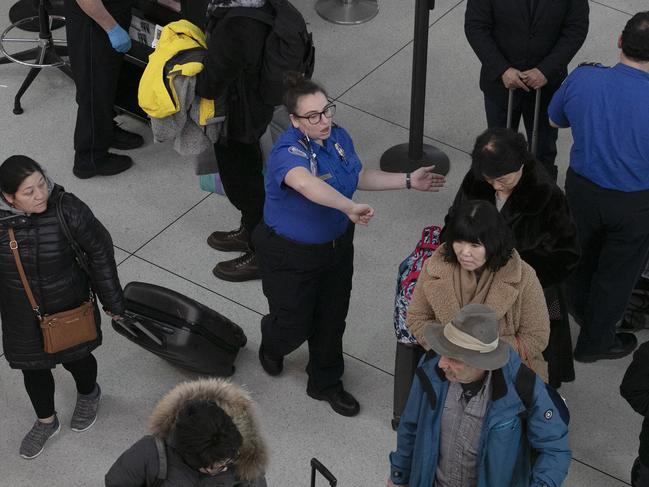 The strain of a 35-day partial government shutdown is weighing on the nation's air-travel system, especially security and air traffic controllers. Picture: AP Photo/Mark Lennihan, File