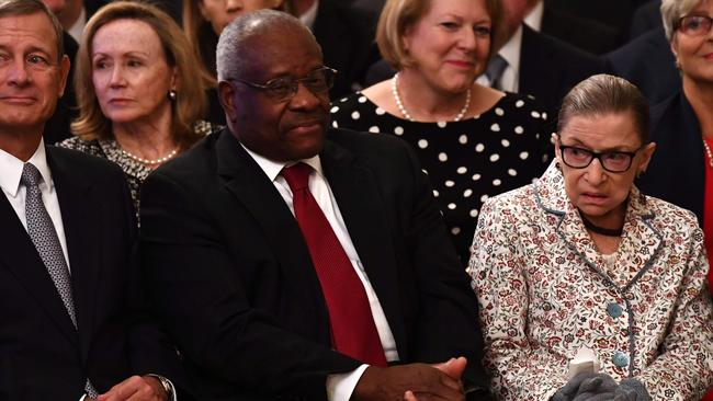 Chief Justice of the US Supreme Court John Roberts and Associate Justices Clarence Thomas and Ruth Bader Ginsburg attend the swearing-in ceremony of Brett Kavanaugh as Associate Justice. Picture: Brendan Smialowski/AFP