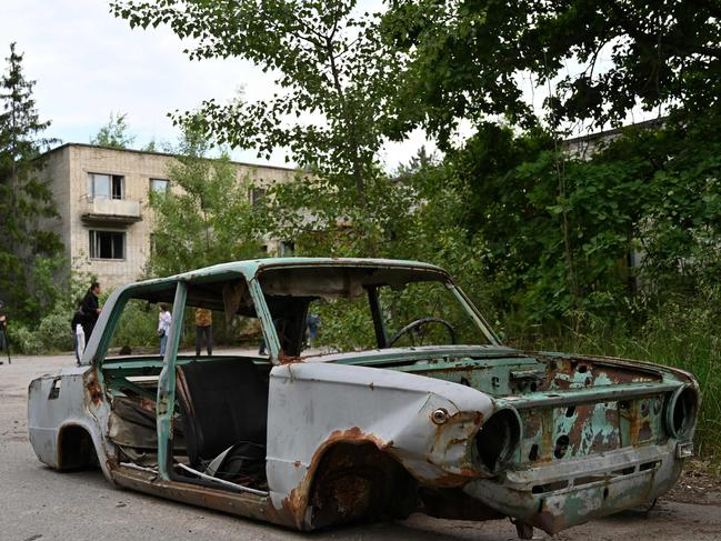 A picture taken on June 7 shows the wreckage of a car in the ghost city of Pripyat in the Chernobyl exclusion zone. Picture: Genya Savilov/AFP
