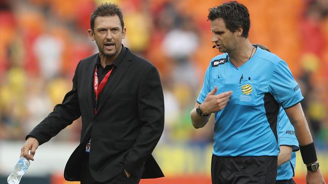 Wanderers coach Tony Popovic makes his point to referee Kris Griffith-Jones as they leave the field.