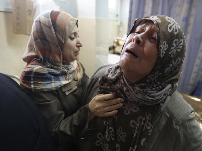 Truce ends ... Palestinian women from the al-Dalo family react at the al-Shifa hospital morgue in Gaza City, after their home was destroyed bn an Israeli air strike. Picture: AFP