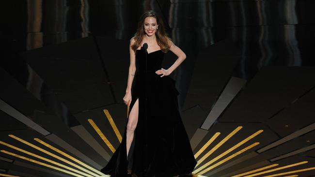 Angelina and her leg on stage at the 2012 Oscars. Picture: AFP