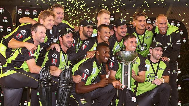 Paddy Upton (top right) celebrates the Big Bash title with the Sydney Thunder players.