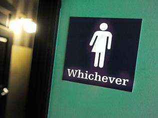 "(FILES) This file photo taken on May 10, 2016 shows a gender neutral sign posted outside a bathroom at Oval Park Grill in Durham, North Carolina. Germany's top court on November 8, 2017 required parliament to legally recognise a ""third gender"" from birth, potentially making it the first European country to offer intersex people the option of identifying as neither male nor female. / AFP PHOTO / GETTY IMAGES NORTH AMERICA / SARA D. DAVIS"
