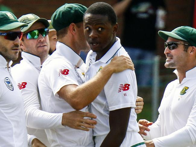 Kagiso Rabada celebrates taking a wicket with his teammates.