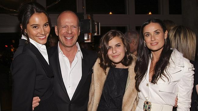 Bruce Willis with his partner, actress Emma Hemming (left), his ex-wife Demi Moore with their daughter Tallulah Belle Willis. Photo: Stephen Lovekin/Getty Images.