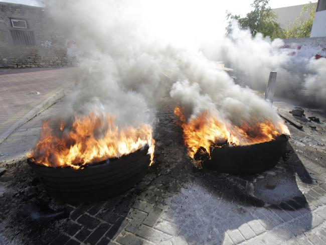 Tire fires burn in a third straight day of protests against Saudi Arabia's execution of Saudi Shiite cleric Sheikh Nimr al-Nimr in the western Shiite village of Karzakan, Bahrain. Picture: AP