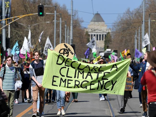 Climate change protesters are seen outside Flinders Street Station. Picture: AAP