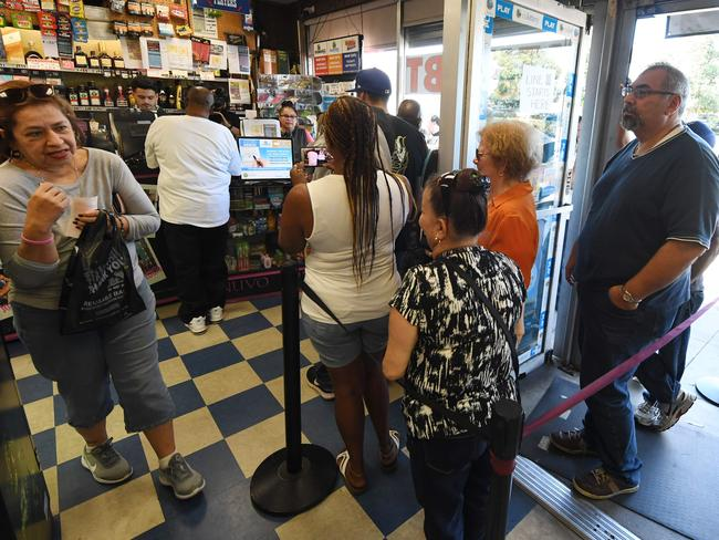 Customers buy Mega Millions tickets hours before the draw of the $1 billion jackpot, at the Bluebird Liquor store in Torrance, California. Picture: Mark Ralston
