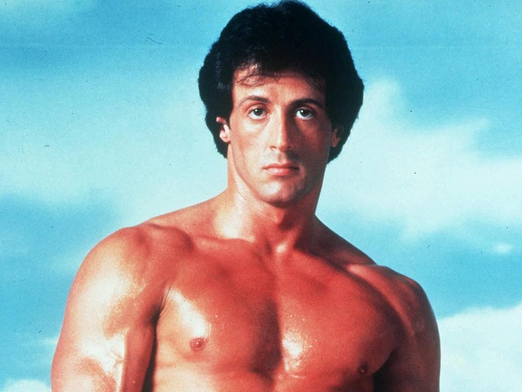 """This undated publicity image originally released by United Artists shows Sylvester Stallone posing in character as Rocky Balboa in the boxing film, """"Rocky.""""(AP Photo/United Artists)"""