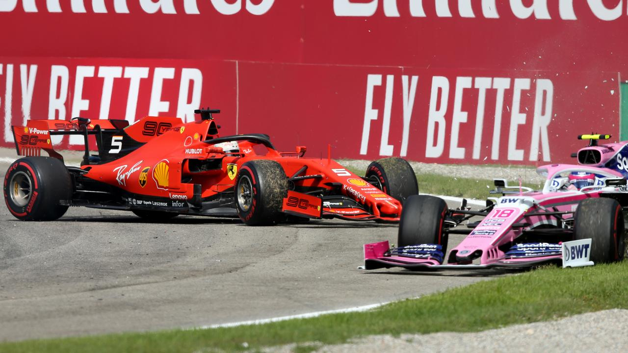 Lance Stroll (L) is tipped into a spin by Vettel in Monza.