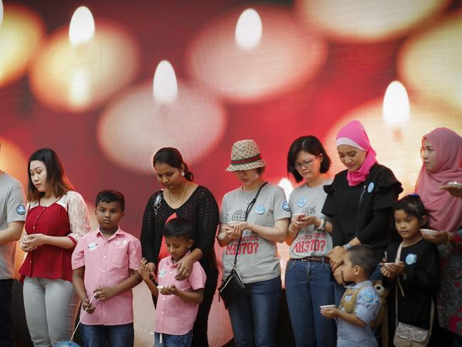 Relatives of passengers of MH370 have a moment of silence during the Day of Remembrance event in Kuala Lumpur. Picture: AP Photo/Vincent Thian