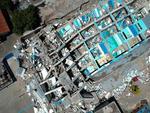 This aerial picture shows the remains of a ten-storey hotel in Palu in Indonesia's Central Sulawesi on September 30, 2018 after it collapsed following a strong earthquake in the area. Picture: Azwar / AFP