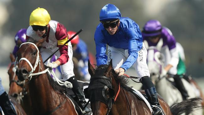 James McDonald guides Tally (blue cap and silks) to victory in the Rosehill Gold Cup