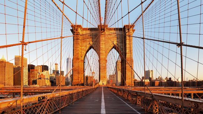 See the Brooklyn Bridge for less by finding the optimum time to book flights to New York. Picture: iStock