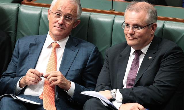 CANBERRA, AUSTRALIA - MAY 05: Prime Minister Malcolm Turnbull and Treasurer Scott Morrison listen to Opposition leader Bill Shorten deliver his budget reply speech on May 5, 2016 in Canberra, Australia. The Turnbull Government's first budget has delivered tax cuts for small and medium businesses, income tax cuts people earning over $80,000 a year,new measures to help young Australians into jobs and cutbacks to superannuation concessions for the wealthy. (Photo by Stefan Postles/Getty Images)