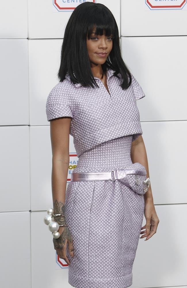Rihanna posing as she arrives to Chanel's ready to wear fall/winter 2014-2015 fashion collection presented in Paris.