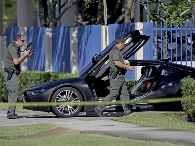 Police investigators surround a vehicle after rapper XXXTentacion was shot on Monday, June 18, 2018, in Deerfield Beach, Florida. Picture: John McCall/South Florida Sun-Sentinel via AP