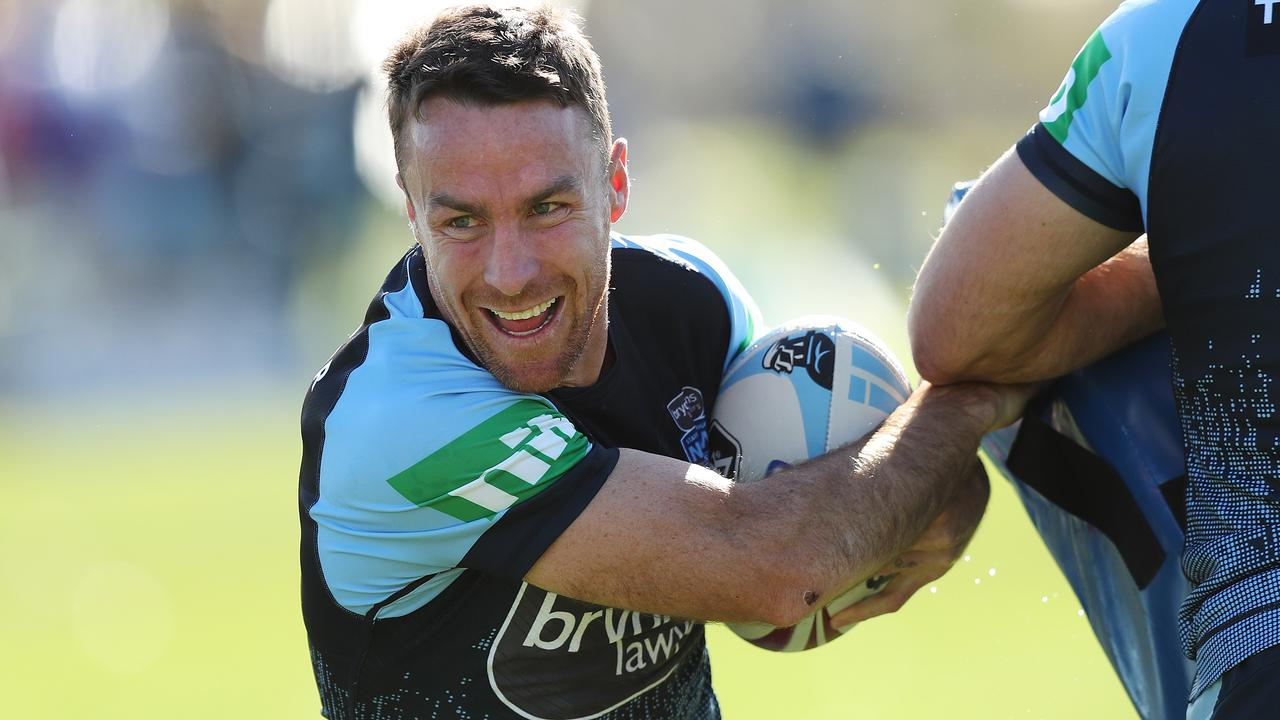 James Maloney after being hit by Josh Addo-Carr during a Blues training session.