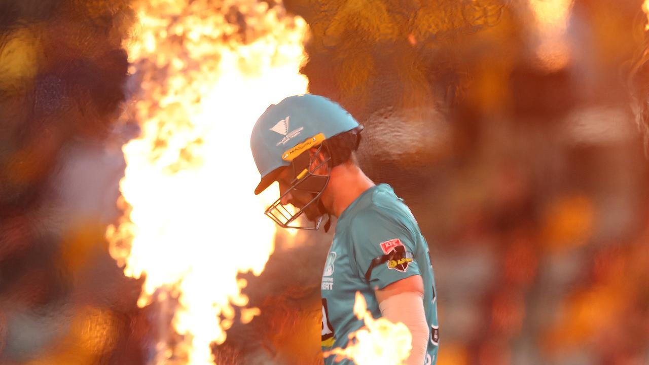 Joe Burns heads out to bat in his return for Brisbane Heat.