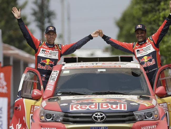 Toyota driver Nasser Al-Attiyah, of Qatar, and co-driver Matthieu Baumel of France.