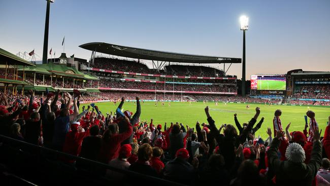 Sydney fans celebrate after Swans beat Port Adelaide. Picture: Phil Hillyard