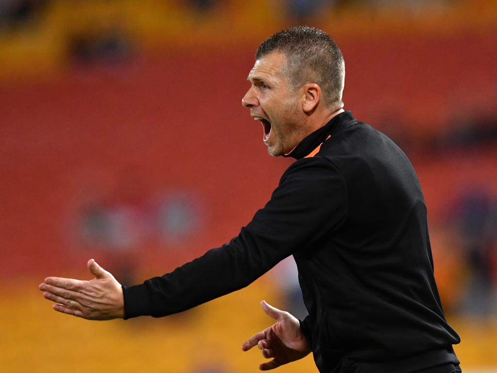 Brisbane Roar coach Darren Davies is seen reacting during the Round 25 A-League match between the Brisbane Roar and Wellington Phoenix at Suncorp Stadium in Brisbane, Friday, April 12, 2019. (AAP Image/Darren England) NO ARCHIVING, EDITORIAL USE ONLY