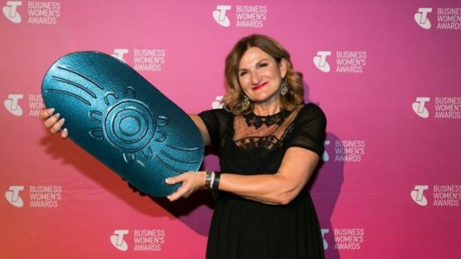 Violet with her award. Photo: Telstra