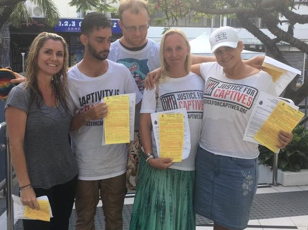 Protesters show off their infringement notices. Picture: Justice for Captives/Facebook