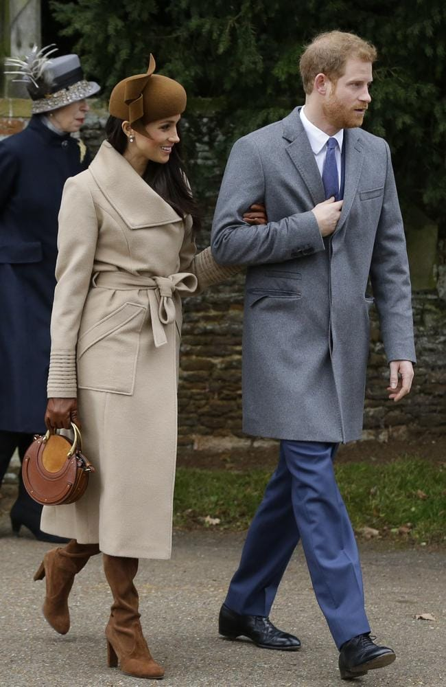 Britain's Prince Harry and his fiancee Meghan Markle walk towards members of the public to greet them following the traditional Christmas Day church service. Picture: AP