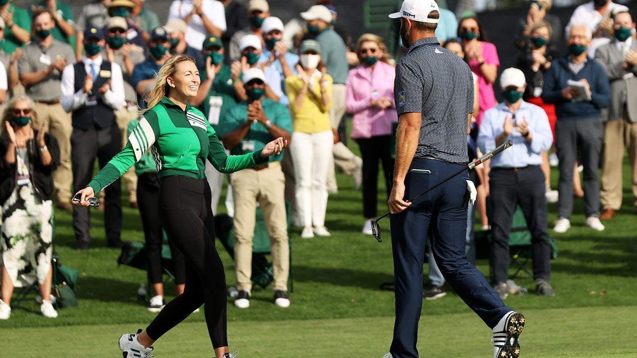 Paulina Gretzky runs on to the green to greet Dustin Johnson. (Photo by Rob Carr/Getty Images)