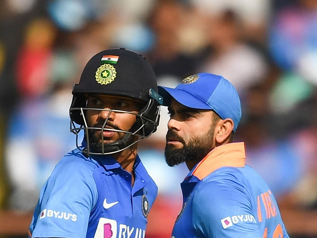 India's captain Virat Kohli (R) and his teammate Shikhar Dhawan take a run during the second one day international (ODI) cricket match of a three-match series between India and Australia at Saurashtra Cricket Association Stadium in Rajkot on January 17, 2020. (Photo by Jewel SAMAD / AFP) / IMAGE RESTRICTED TO EDITORIAL USE - STRICTLY NO COMMERCIAL USE