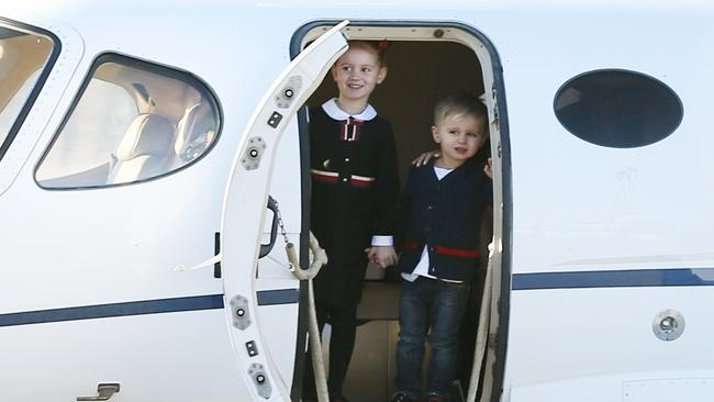 Oliver Curtis greets his children, Pixie and Hunter, on the tarmac in their private jet. Picture: Stephen Cooper.