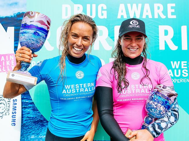 Tyler Wright and Sally Fitzgibbons with their trophies at the Margaret River Pro earlier this year.