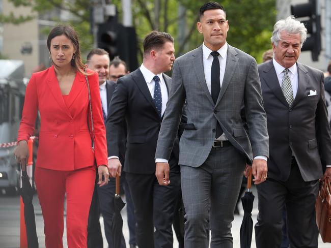 Folau arrived with wife Maria by his side.