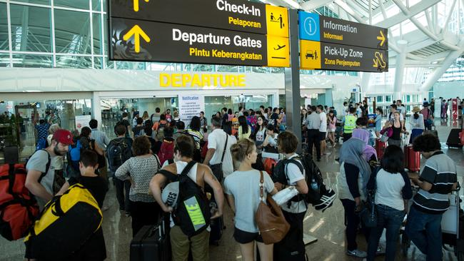 Foreign tourists seeking flight information at Ngurah Rai Airport in Denpasar, during the volcanic ash delays last July. Picture: Agung Parameswara/Getty Images