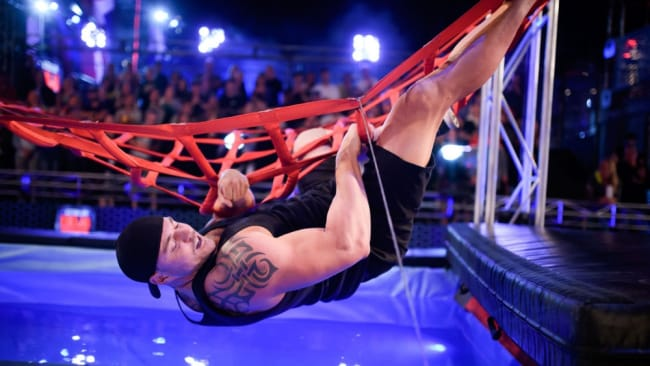 The man is a literal expert at hanging in there. Photo: 'Australian Ninja Warrior'