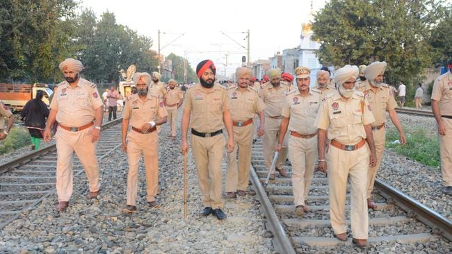 Indian Punjab Police personnel walk at the scene of the accident along railroad tracks in Amritsar on October 20, 2018. Picture: AFP