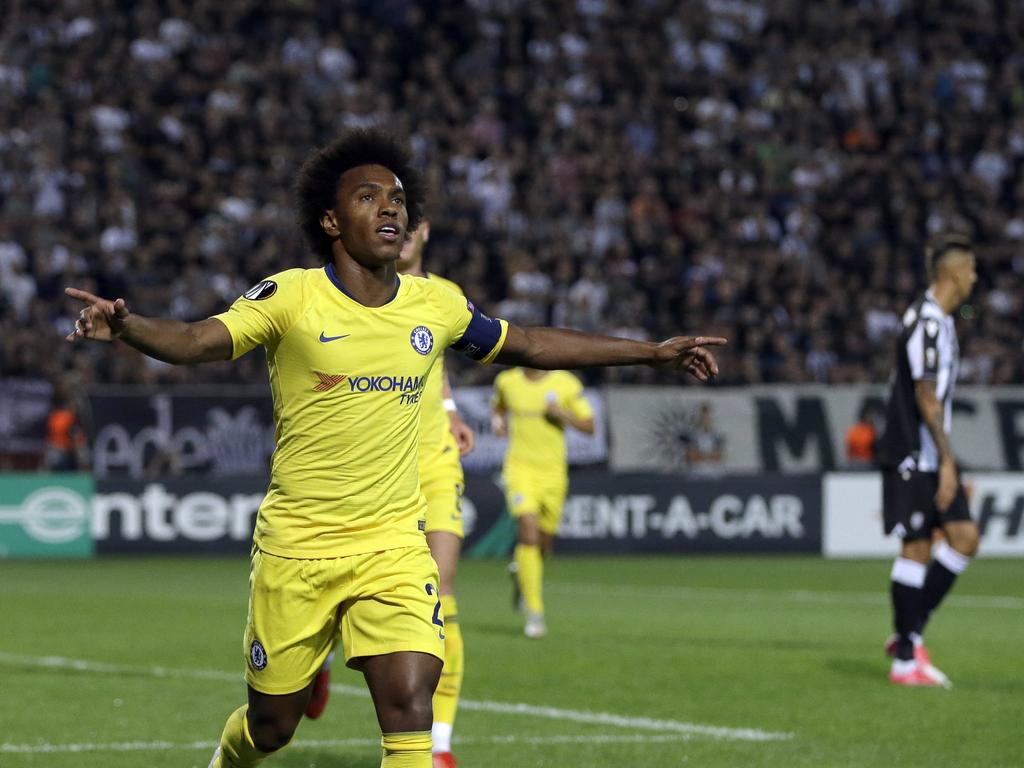 Chelsea's Willian celebrates after scoring his side's opening goal during a Group L Europa League soccer match between PAOK and Chelsea at Toumba stadium in the northern Greek port city of Thessaloniki, Thursday, Sept. 20, 2018. (AP Photo/Thanassis Stavrakis)