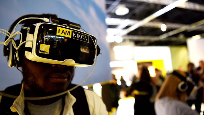 A man views photos from Nikon's first 360-degree camera. Photo: AFP PHOTO / PATRIK STOLLARZ.