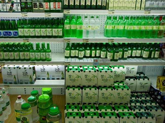 Shop shelves filled with a variety of Soju bottles, which is the national drink.