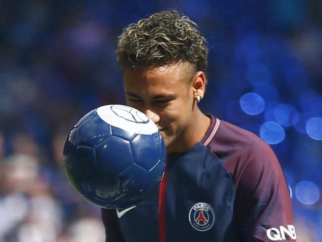 Brazilian soccer star Neymar eyes the ball.
