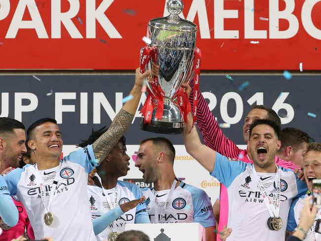 Tim Cahill and Bruno Fornaroli lift the FFA Cup. Picture: Wayne Ludbey