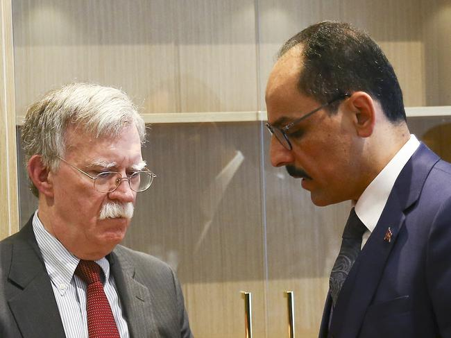 "US National Security Adviser John Bolton, left, and his Turkish counterpart Ibrahim Kalin. Mr Kalin suggested threats from Mr Trump played into ""terrorist propaganda"". Picture: AP"
