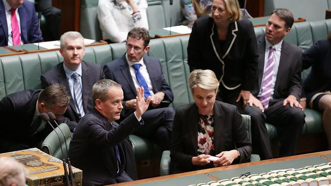 Big moment ... Bill Shorten acknowledges the public gallery as he introduces the bill.