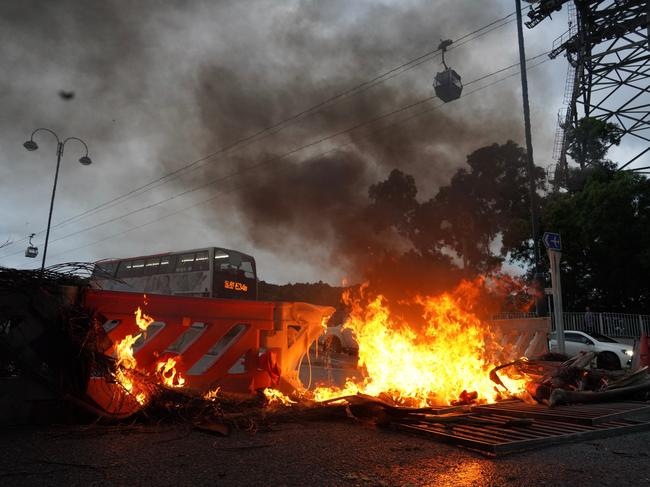 Protesters set fire to barricades at Tung Chung near the Hong Kong airport. Picture: Vincent Yu